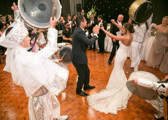 Married couple dancing on Florlok portable dance floor during their wedding party